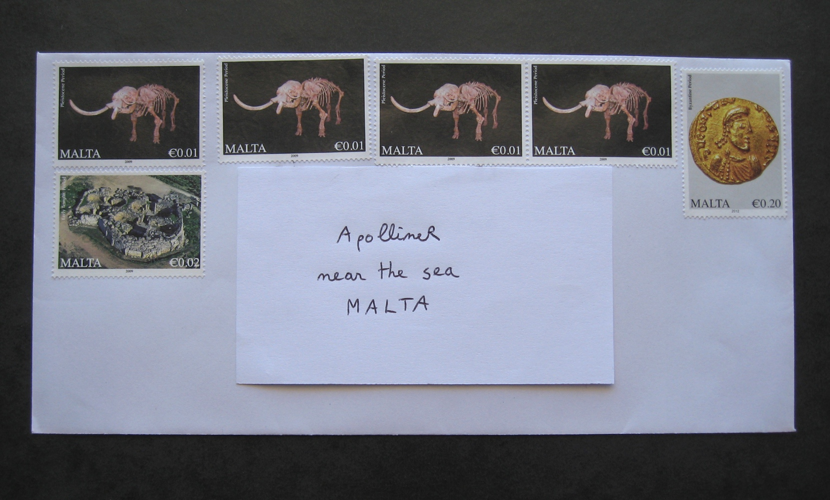 Envelope covered in Maltese stamps