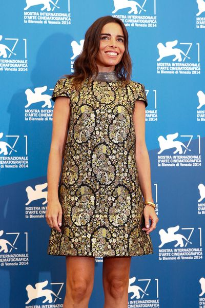 Elodie Bouchez Saint Laurent black and gold trapeze dress at 2014 Venice Film Festival