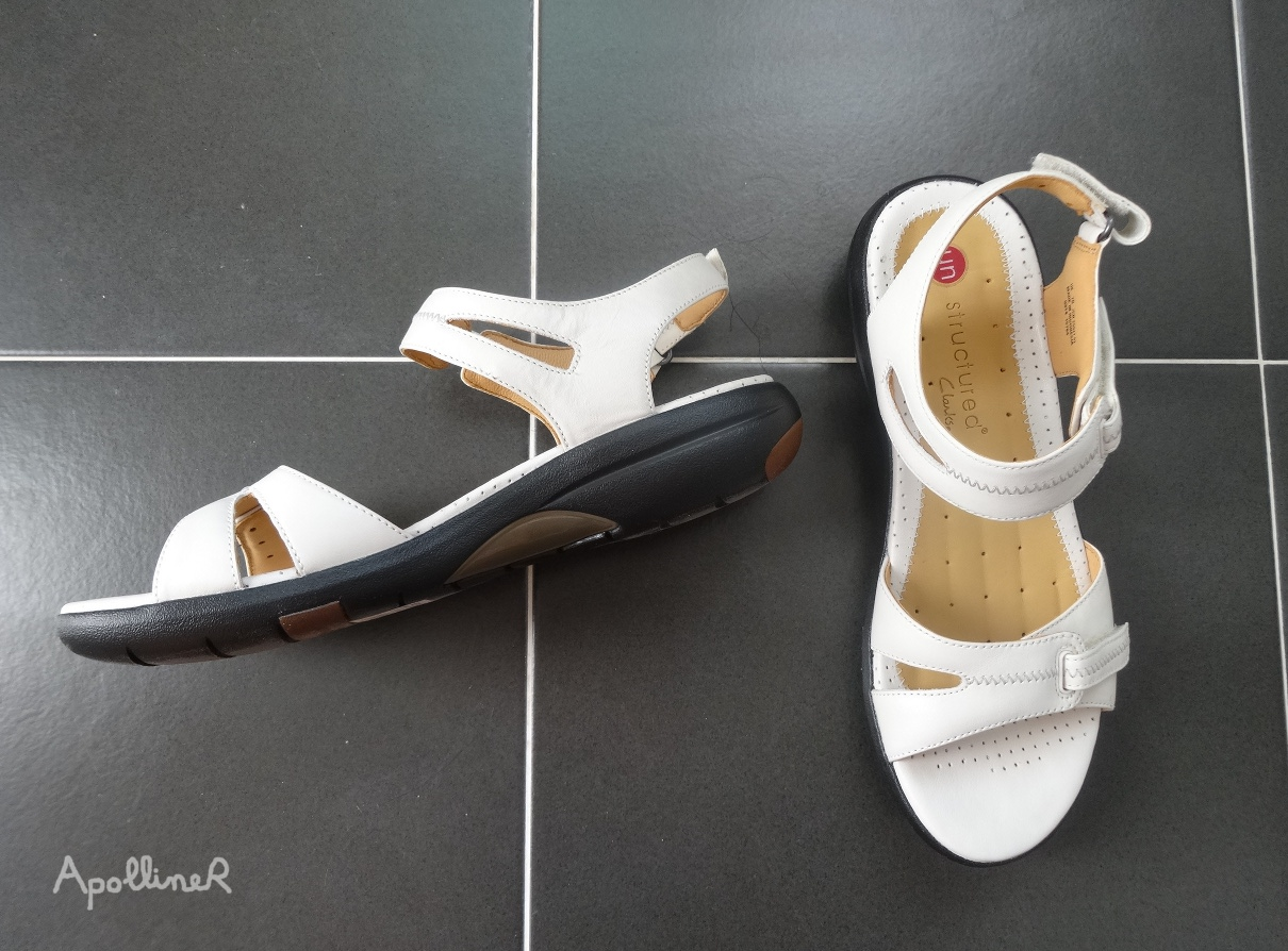a pair of Clarks Unstructured sandals