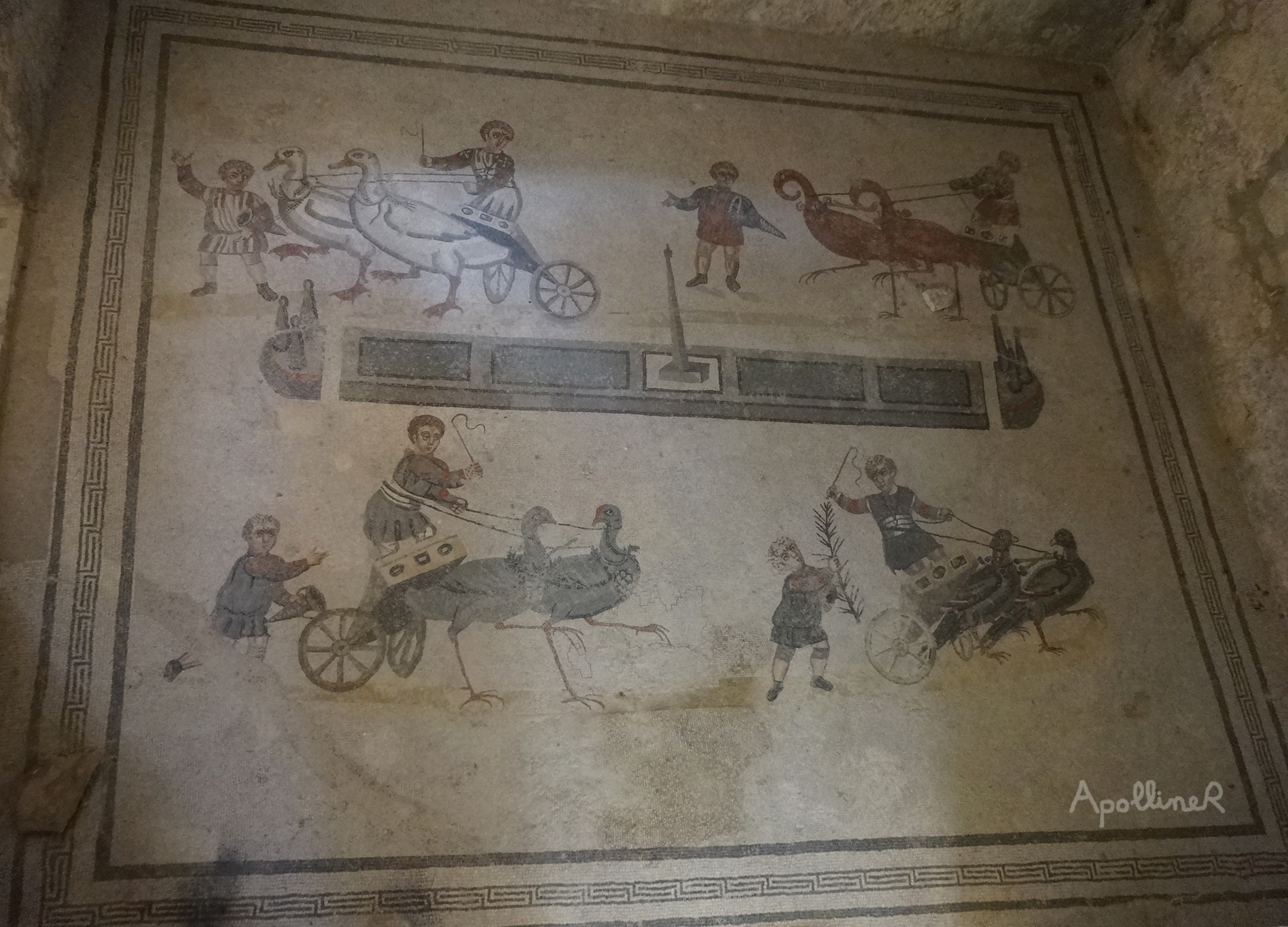 Roman mosaic showing children racing in chariots pulled by birds. Villa Romana Del Casale in Sicily
