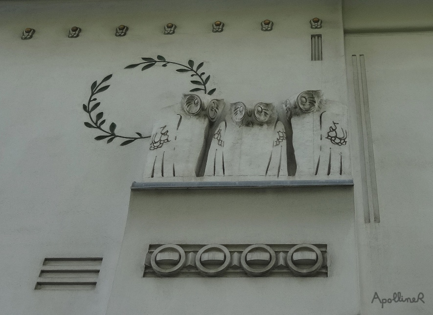 Secession building in Vienna. Owls statues and crown of laurels on the facade